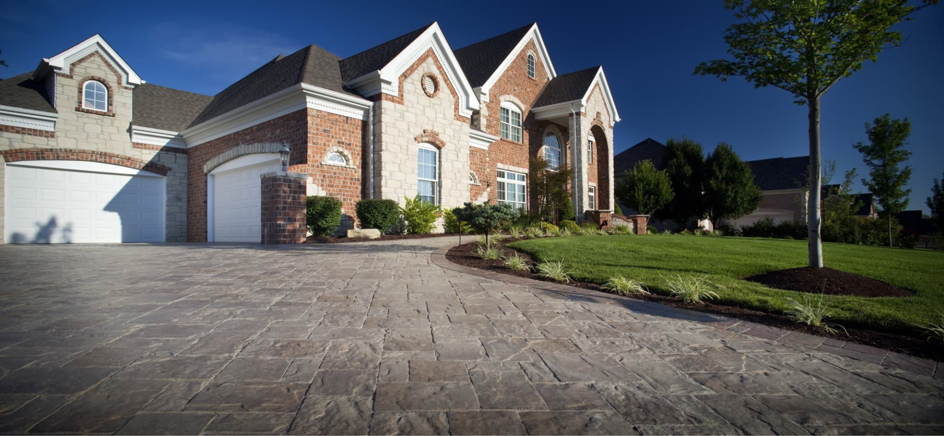 A beautifully landscaped front entrance